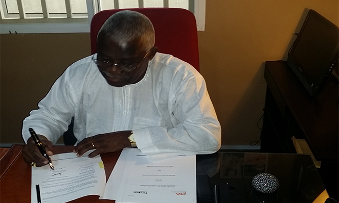 the Chairman and Chief Executive of FAYODE signing the agreement